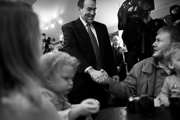 December 8, 2007. Columbia, SC.. Former Arkansas governor and presidential contender Mike Huckabee greeted diners at the Lizard's Thicket Restaurant in Columbia, SC, where he discussed his rise in the polls and the future of his campaign.. Huckabee greeted diner James Martin, and his daughters Emma (right) and Kate (left).