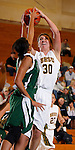 SPEARFISH, SD - JANUARY 4, 2013:  Cassidy Kotelman #30 of Black Hills State tries to shoot over Adams State defender Jalea Crump #4 during their Rocky Mountain Athletic Conference Basketball game Friday at the Young Center in Spearfish, S.D.  (Photo by Richard Carlson/dakotapress.org)