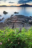Cracked rocky shoreline of Washington Park at sunset with San Juan Islands in background, Fidalgo Island, Skagit County, Washington, USA