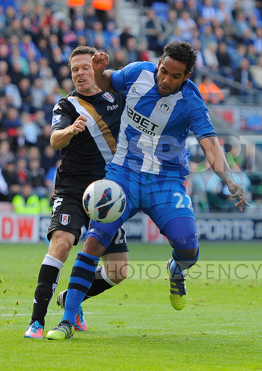 Jean Beausejour of Wigan holds off Sascha Riether of Fulham.Barclays Premier League - Wigan Athletic vs Fulham - DW Stadium - Wigan - 22/09/12 - Picture Simon Bellis/Sportimage