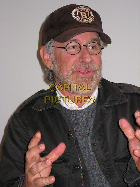 STEVEN SPIELBERG.Photocall for ?Indiana Jones and the Kingdom of the Crystal Skull? at the Four Seasons (Burton Room) in Los Angeles, California, USA..May 9th, 2008.headshot portrait brown university baseball cap hat black glasses beard facial hair hand.CAP/AW.©Anita Weber/Capital Pictures.