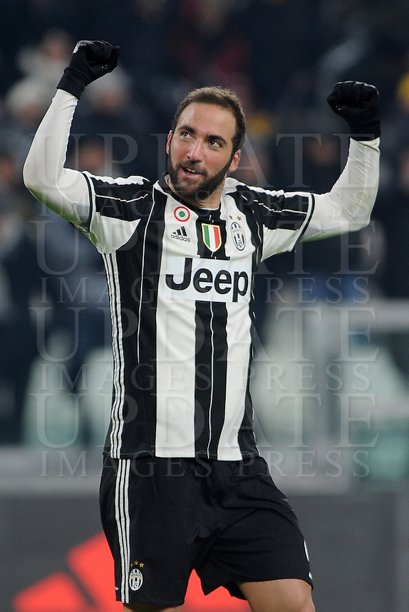 Calcio, Serie A: Juventus vs Bologna. Torino, Juventus Stadium, 8 gennaio 2017.<br /> Juventus' Gonzalo Higuain celebrates after scoring his second goal during the Italian Serie A football match between Juventus and Bologna at Turin's Juventus Stadium, 8 January 2017. Juventus won 3-0.<br /> UPDATE IMAGES PRESS/Manuela Viganti