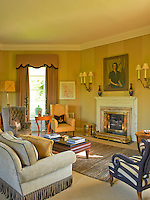 A 1940s portrait hangs above the fireplace in this informal living room