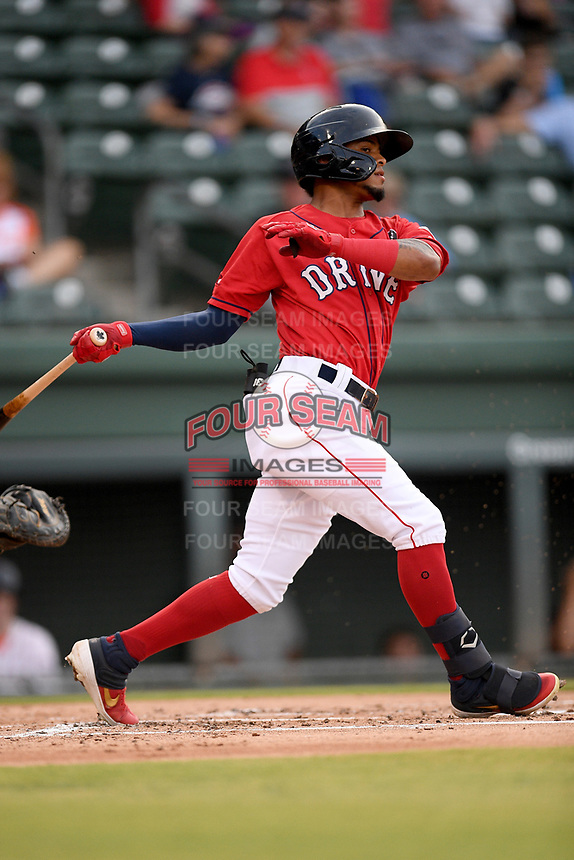 Right fielder Kervin Suarez (4) of the Greenville Drive bats in a game against the Asheville Tourists on Friday, August 23, 2019, at Fluor Field at the West End in Greenville, South Carolina. Greenville won, 11-1. (Tom Priddy/Four Seam Images)