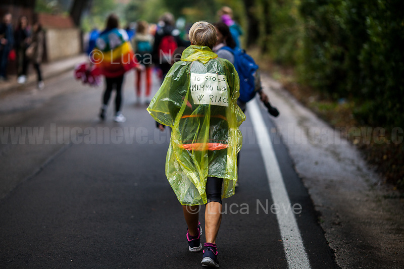 Unknown, Marcher.<br /> <br /> Rome, 01/05/2019. This year I will not go to a MayDay Parade, I will not photograph Red flags, trade unionists, activists, thousands of members of the public marching, celebrating, chanting, fighting, marking the International Worker's Day. This year, I decided to show some of the Workers I had the chance to meet and document while at Work. This Story is dedicated to all the people who work, to all the People who are struggling to find a job, to the underpaid, to the exploited, and to the people who work in slave conditions, another way is really possible, and it is not the usual meaningless slogan: MAKE MAYDAY EVERYDAY!<br /> <br /> Happy International Workers Day, long live MayDay!