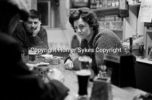County Kerry Ireland Eire 1969,  friends playing card game in village pub. 1960s