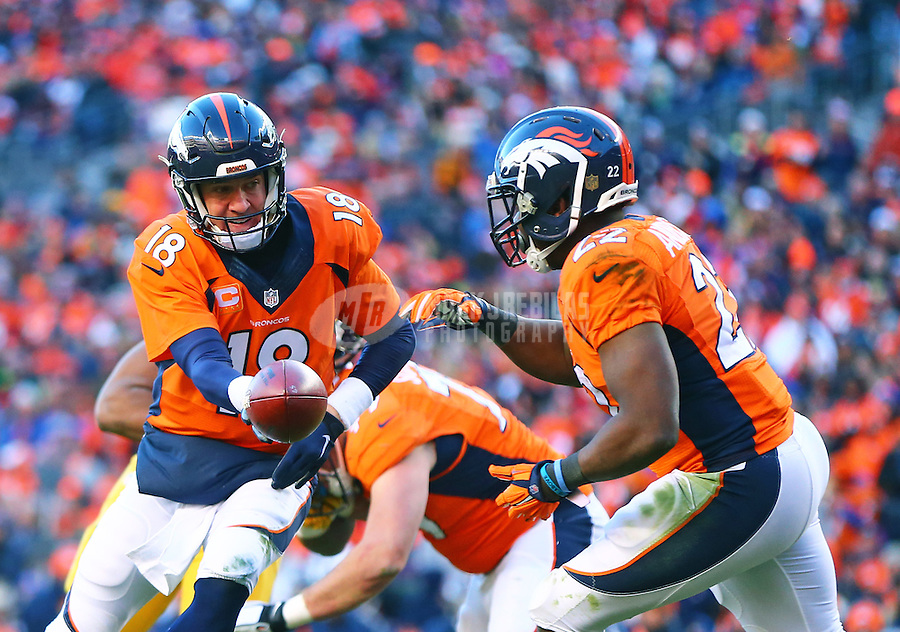 Jan 17, 2016; Denver, CO, USA; Denver Broncos quarterback Peyton Manning (18) hands off the ball to running back C.J. Anderson (22) against the Pittsburgh Steelers during the AFC Divisional round playoff game at Sports Authority Field at Mile High. Mandatory Credit: Mark J. Rebilas-USA TODAY Sports