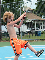 It was hot and humid, but that didn't stop six-year-old Levin Kerrigan from playing tennis with his dad, Shane, recently at Kenwick on the Lake, Brights Grove. Shane and Charity Kerrigan, of Quebec and their three children were visiting family in Brights Grove. Following the workout they went for a swim in Lake Huron to cool off.