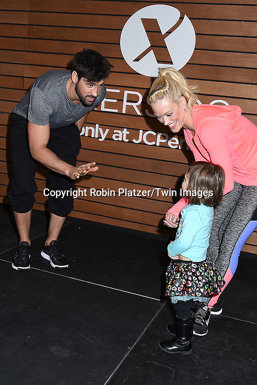 Maxim Chmerkovskiy and fiancee Peta Murgatroyd  host a Fitness Event with Dance Session at the JC Penney at the Manhattan Mall on January 21, 2016 in New York City, New York, USA. They were wearing the latest from the Xersion activewear line. <br /> <br /> photo by Robin Platzer/Twin Images<br />  <br /> phone number 212-935-0770