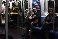 NEW YORK, NY - JANUARY 12: Participants of the No Pants Subway Ride take a ride on the NYC subway system on January 12, 2020 in New York. The annual event, in which participants board a subway car in January while not wearing any pants while behaving as though they do not know each other, began as a joke by the public prank group Improv Everywhere in New York City and has since spread around the world, with enthusiasts in around 60 cities and 29 countries across the globe, according to the organization's site.   (Photo by Joana Toro/VIEWpress)