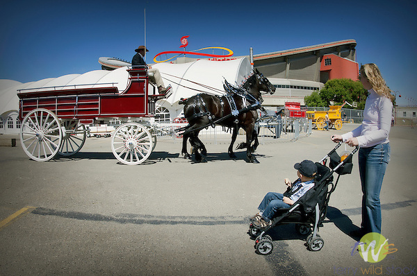 Mother and child at Arena viewing horse and buggy. Calgary, CAN