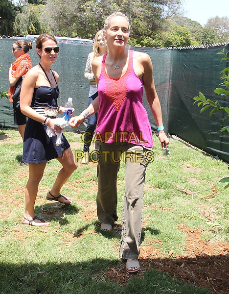 Sharon Stone.Elizabeth Glaser Pediatric AIDS Foundation's 23rd Annual 'A Time For Heroes' Celebrity Picnic held at The Wadsworth Theater, Los Angeles, California, USA..3rd June 2012.full length top sleeveless pink red top brown trousers walking.CAP/ADM/FS.©Faye Sadou/AdMedia/Capital Pictures.