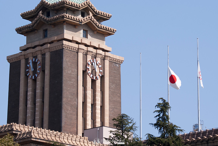 The Japanese and Nagoya City flags at half-mast on the first March 11th earthquake disaster anniversay.