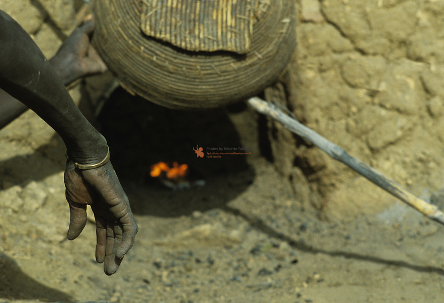 It enables an air draft, it is used to check the level of slag that is formed during the fusion,  and also allows the slag to be removed from the furnace with a wooden stick