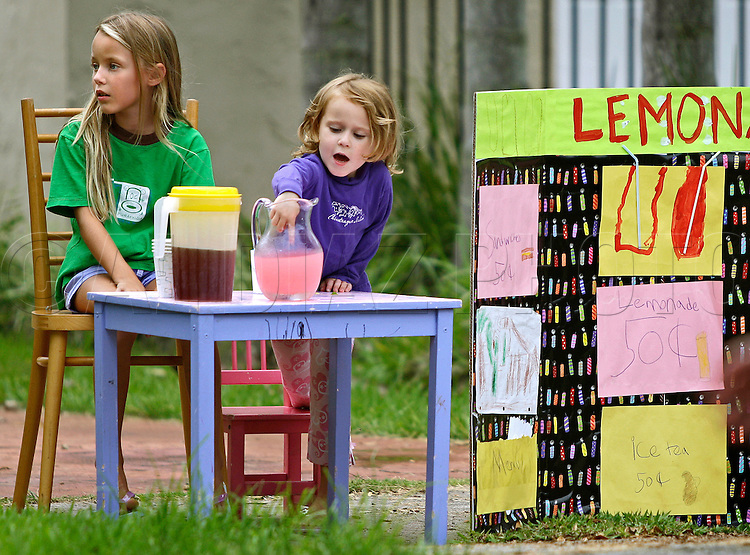 8-05-08 Al DIAZ / MIAMI HERALD STAFF -- Fiona Baker, 4, sneeks in a taste of lemonade as her sister Laurel Baker,8, watches for thirsty buyers in the North Gables.