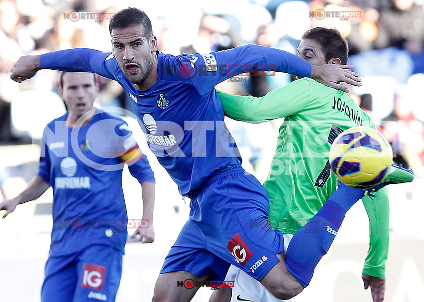 Getafe's Alberto Lopo (l) and Malaga's Joaquin Sanchez during La Liga match.December 01,2012. (ALTERPHOTOS/Acero) ©/NortePhoto