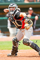 Kannapolis Intimidators catcher Martin Medina #18 makes a throw to first base against the Greensboro Grasshoppers at NewBridge Bank Park on May 16, 2012 in Greensboro, North Carolina.  The Grasshoppers defeated the Intimidators 10-8 in 11 innings.  (Brian Westerholt/Four Seam Images)