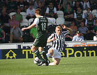Gary Teale tackling Alan Maybury in the St Mirren v Hibernian Clydesdale Bank Scottish Premier League match played at St Mirren Park, Paisley on 18.8.12.
