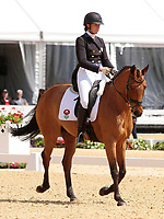 LEXINGTON, KY - April 27, 2017. #33 Vermiculus and Lauren Kieffer from the USA finish 2nd on the first day of the Dressage test at the Rolex Three Day Event at the Kentucky Horse Park.  Lexington, Kentucky. (Photo by Candice Chavez/Eclipse Sportswire/Getty Images)