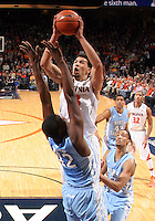 Virginia forward Anthony Gill (13) shoots over North Carolina forward Joel James (42) during an NCAA basketball game against Virginia Monday Jan. 20, 2014 in Charlottesville, VA. Virginia defeated North Carolina 76-61.