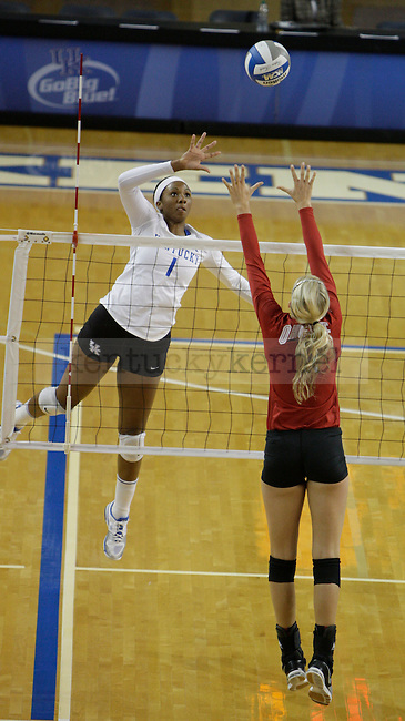 Junior Whitney Billings (1) spikes the ball during the UK women's volleyball game v. Ohio University during the second round of the NCAA tournament in Memorial Coliseum in Lexington, Ky., on Saturday, December 1, 2012. Photo by Genevieve Adams   Staff