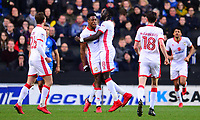 Chuks Aneke of Mk Dons celebrates with his team mates after he scores to make it 1-0 during the Sky Bet League 1 match between MK Dons and Peterborough at stadium:mk, Milton Keynes, England on 30 December 2017. Photo by Bradley Collyer / PRiME Media Images.