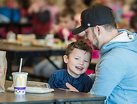 NWA Democrat-Gazette/ANTHONY REYES @NWATONYR<br /> John Bennet hugs his son Jude Bennet, 6, Friday, Feb. 3, 2017 after they ate lunch together at Willowbrook Elementary School in Bentonville. Bennet said he or his wife try to come and eat lunch with Jude a couple of times a month. More parents have taken the time to occasionally eat lunch with their children at school.