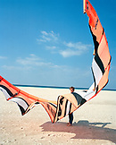 SPAIN, Andalusia, Tarifa, man with kite surfing gear on beach