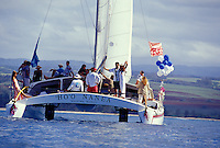Wedding couple aboard the catamaran Ho'o Nanea, sailing out of Haleiwa Harbor, on the North Shore of Oahu, Hawaii