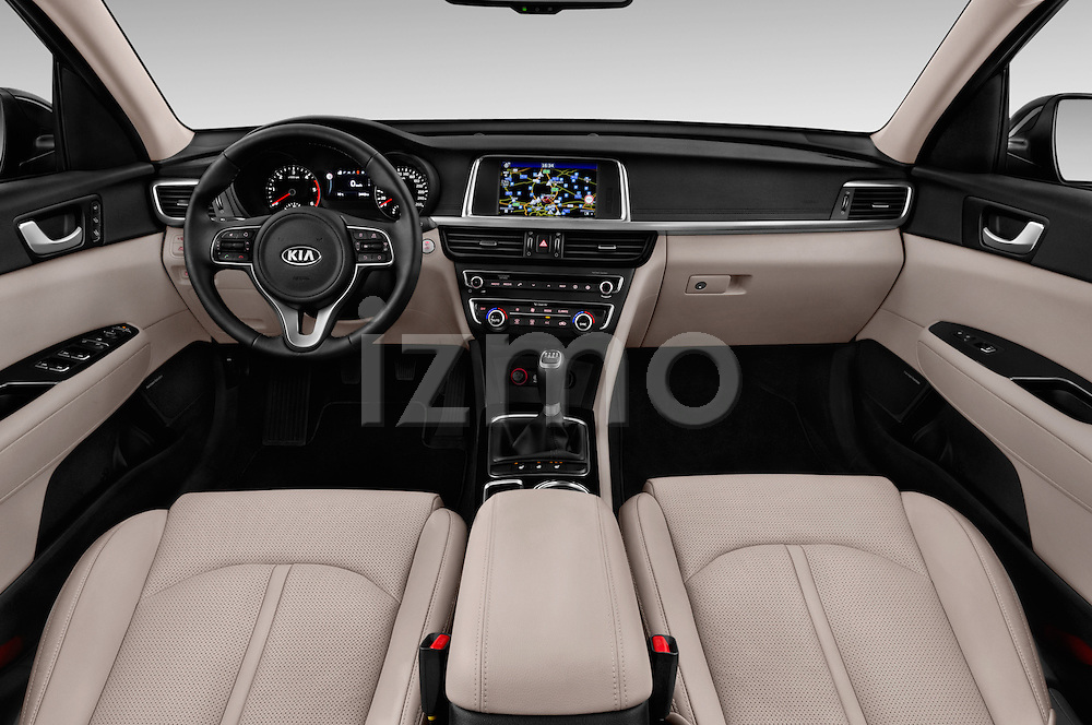 Stock photo of straight dashboard view of 2016 KIA Optima Sense 4 Door Sedan Dashboard