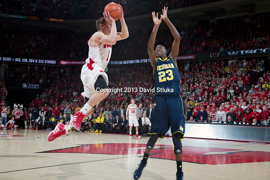 Wisconsin Badgers guard Ben Brust (1) hits a 3-pointer as time expires in regulation to tie the game during a Big Ten Conference NCAA college basketball game against the Michigan Wolverines Saturday, February 9, 2013, in Madison, Wis. The Badgers won 65-62 (OT). (Photo by David Stluka)