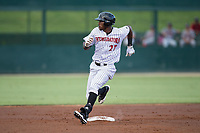 Micker Adolfo (27) of the Kannapolis Intimidators watches the ball in the outfield as he rounds second base during the game against the Hagerstown Suns at Kannapolis Intimidators Stadium on June 14, 2017 in Kannapolis, North Carolina.  The Intimidators defeated the Suns 10-1 in game two of a double-header.  (Brian Westerholt/Four Seam Images)