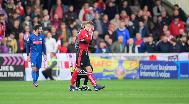 Lincoln City's Michael O'Connor is forced off in the second half with an injury<br /> <br /> Photographer Chris Vaughan/CameraSport<br /> <br /> The EFL Sky Bet League One - Lincoln City v Sunderland - Saturday 5th October 2019 - Sincil Bank - Lincoln<br /> <br /> World Copyright © 2019 CameraSport. All rights reserved. 43 Linden Ave. Countesthorpe. Leicester. England. LE8 5PG - Tel: +44 (0) 116 277 4147 - admin@camerasport.com - www.camerasport.com