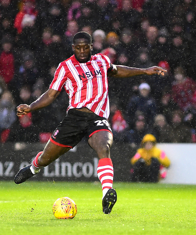 Lincoln City's John Akinde<br /> <br /> Photographer Andrew Vaughan/CameraSport<br /> <br /> The EFL Sky Bet League Two - Saturday 15th December 2018 - Lincoln City v Morecambe - Sincil Bank - Lincoln<br /> <br /> World Copyright © 2018 CameraSport. All rights reserved. 43 Linden Ave. Countesthorpe. Leicester. England. LE8 5PG - Tel: +44 (0) 116 277 4147 - admin@camerasport.com - www.camerasport.com