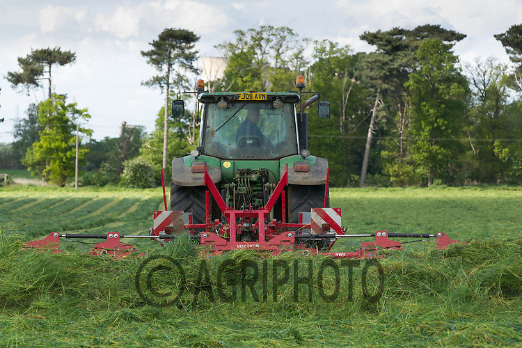 A contractor turning grass for silage on a Dairy farm with a John Deere tractor and Lely Lotus turner<br /> Picture Tim Scrivener 07850 303986