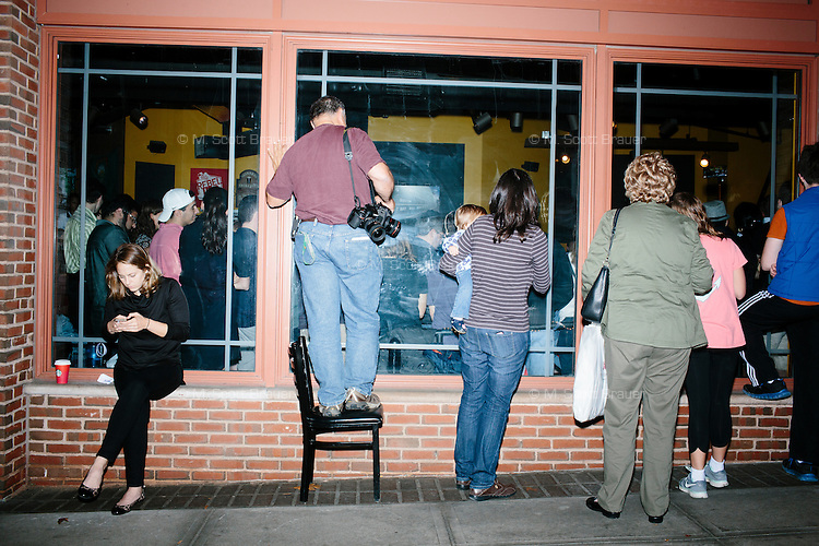 People gather outside the packed room to hear Republican presidential candidate and New Jersey governor Chris Christie speak to a crowd at the Salt Hill Pub in Hanover, New Hampshire.