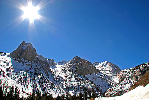 The sun bursts with high energy on a cloudless day at Pine Creek in the Sierra Nevada Mountains near Bishop, California