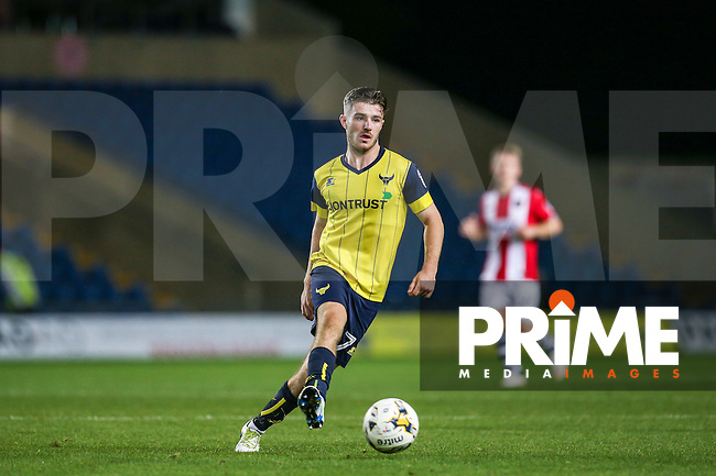 Dan Crowley of Oxford United plays a pass during the The Checkatrade Trophy match between Oxford United and Exeter City at the Kassam Stadium, Oxford, England on 30 August 2016. Photo by Andy Rowland / PRiME Media Images.
