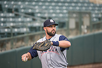 Nevin AShley (31) of the Colorado Springs Sky Sox warms up in the outfield prior to the Pacific Coast League game against the Salt Lake Bees at Smith's Ballpark on May 22, 2015 in Salt Lake City, Utah.  (Stephen Smith/Four Seam Images)