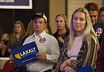Supporters watch as Adam Laxalt gives his concession speech at the Grand Sierra Resort in Reno, Nev., Tuesday, Nov. 6, 2018. (AP Photo/Tom R. Smedes)