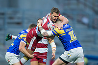 Picture by Allan McKenzie/SWpix.com - 13/04/2018 - Rugby League - Betfred Super League - Leeds Rhinos v Wigan Warriors - Headingley Carnegie Stadium, Leeds, England - Wigan's Sean O'Loughlin is tackled by Leeds's Stevie Ward and Brad Singleton.