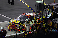 Clint Bowyer (#15) makes a pit stop.