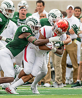 NWA Democrat-Gazette/BEN GOFF @NWABENGOFF<br /> Braylin Scott (left), Colorado State defensive back, and V.J. Banks, Colorado State cornerback, tackle Devwah Whaley, Arkansas running back, in the 1st quarter Saturday, Sept. 8, 2018, at Canvas Stadium in Fort Collins, Colo.