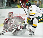 24 November 2009: University of Vermont Catamount forward Jack Downing, a Junior from New Canaan, CT, checks University of Massachusetts Minutemen defenseman Justin Braun, a Senior from Vadnais Heights, MN, during game action at Gutterson Fieldhouse in Burlington, Vermont. The Minutemen defeated the Catamounts 6-2. Mandatory Credit: Ed Wolfstein Photo