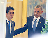United States President Barack Obama, right, and Prime Minister Shinzo Abe of Japan, left, prepare to depart the Oval Office after conducting a joint press conference in the Rose Garden of the White House in Washington, D.C. on Tuesday, April 28, 2015.<br /> Credit: Ron Sachs / CNP
