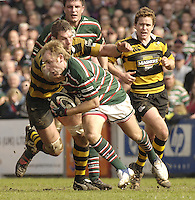 Leicester, ENGLAND,Tiger Andy Goode scoop's up the loose ball as Wasp's Simon Shaw make a tackle, during the Guinness Premiership Rugby match,  Leicester Tigers vs London Wasps, at Welford Road, © Peter Spurrier/Intersport-images.com.