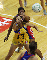Vilimaina Davu tries to block a pass to Pulse goalshoot Jamilah Gupwell (front) during the ANZ Netball Championship match between the Central Pulse and Northern Mystics, TSB Bank Arena, Wellington, New Zealand on Monday, 4 May 2009. Photo: Dave Lintott / lintottphoto.co.nz