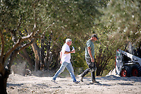 Pictured: Eddie Needham (L), the grandfather of missing Ben Needham with a South Yorkshire Police officer in Kos, Greece. Wednesday 05 October 2016<br />