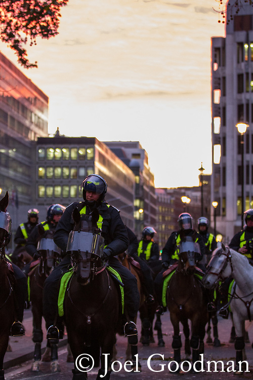 © Joel Goodman - 07973 332324 . 09/12/2010 . London , UK . Students and their supporters clash with mounted police during a demonstration in Parliament Square in London against government cuts to student support , Educational Maintenance Allowance ( EMA ) and rising university tuition fees . Photo credit : Joel Goodman