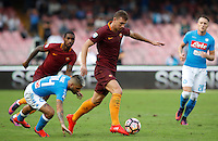 Calcio, Serie A: Napoli vs Roma. Napoli, stadio San Paolo, 15 ottobre. <br /> Roma&rsquo;s Edin Dzeko, right, is challenged by Napoli&rsquo;s Lorenzo Insigne during the Italian Serie A football match between Napoli and Roma at Naples' San Paolo stadium, 15 October 2016. Roma won 3-1.<br /> UPDATE IMAGES PRESS/Isabella Bonotto